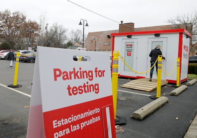 A woman enters an outbuilding designated for rapid-result COVID-19 testing in the parking lot of the CVS pharmacy on Main Street in Bexley on Monday.