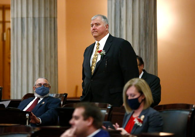 State Rep. Larry Householder walks to the front of the Ohio House chamber to be sworn in Jan. 4. The former House Speaker is under federal indictment.