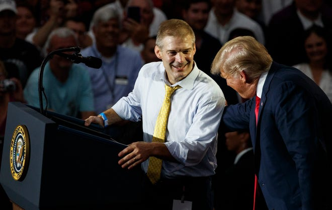 Rep. Jim Jordan, R-Ohio, looks to President Donald Trump as he speaks at a rally at Olentangy Orange High School in Lewis Center, Ohio, Saturday, Aug. 4, 2018.