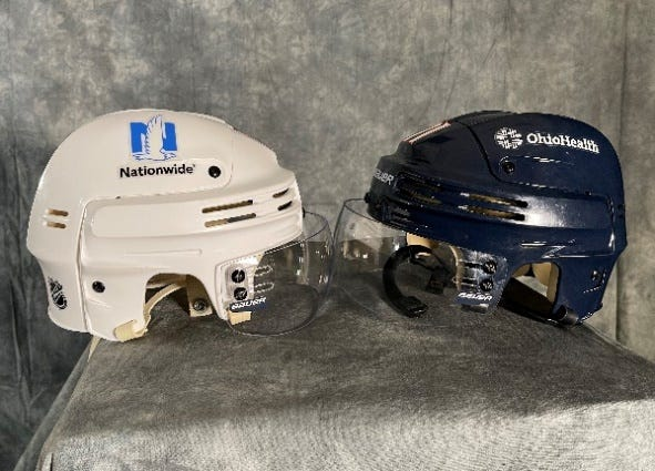The logos of OhioHealth and Nationwide will adorn the helmets of Blue Jackets players this season.