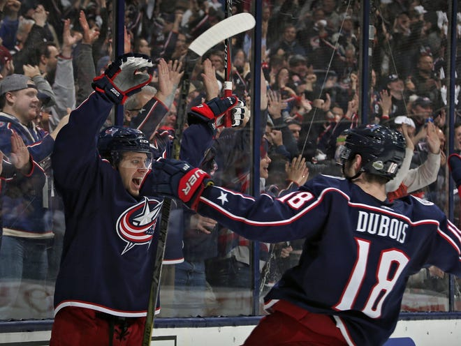 Pierre-Luc Dubois, celebrating a goal by Artemi Panarin, left, against the Capitals in a playoff game in 2018, says the Blue Jackets won't have to worry about his effort on the ice even though he's apparently requested a trade from the team.