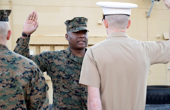 Montrell Bronson is sworn in as staff sgt. in Leesburg on Monday. [Cindy Peterson/Correspondent]