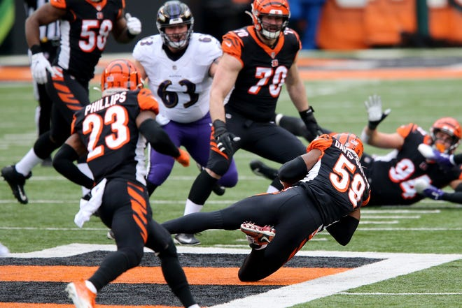 Cincinnati Bengals linebacker Akeem Davis-Gaither (59) intercepts a tipped pass in the second quarter during a Week 17 NFL football game against the Baltimore Ravens on Sunday at Paul Brown Stadium in Cincinnati.