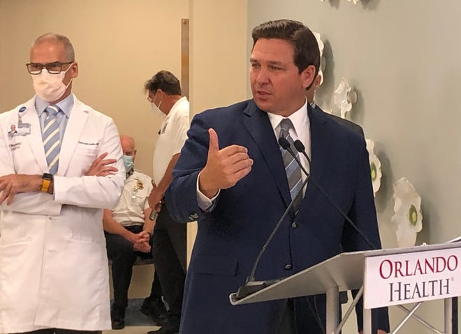 """Gov. Ron DeSantis says he wants hospitals that get shipments of the COVID-19 vaccines to distribute them quickly. """"We want the shots to go in the arms,"""" DeSantis said at a news conference on Monday, Jan. 4, 2021, at Orlando Health South Seminole Hospital in Longwood."""