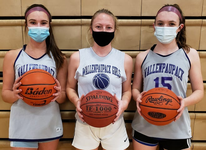 Masked up for safety prior to school shutdown, Devon Kiesendahl, Makenna Peet, and Meg Desmet are hoping to have a positive season leading the Wallenpaupack Area on the court.