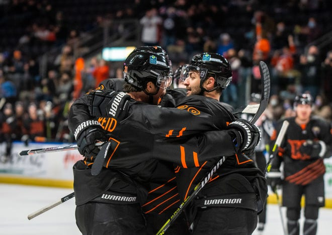 Mavericks forward Giorgio Estpehan, right, celebrates his third-period goal with Brodie Reid in a 4-1 win over Tulsa on New Year's Eve,