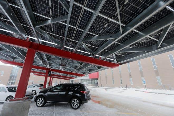 Vehicles are parked under a solar carport canopy Monday in the parking lot of Southeastern Community College's Health Science Complex in West Burlington. The community college was honored with the Renewable Energy category Best Development Award in 2020 by 1,000 Friends of Iowa. SCC was selected for its addition of solar rooftop and carport canopies to reduce its carbon footprint.