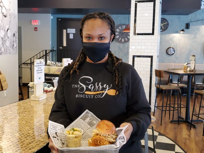 Jilan Hall-Johnson, owner and manager of The Sassy Biscuit and now Jook, shows off one of the chicken sandwiches that will be available beginning Thursday, Jan. 7, when Jook officially opens for takeout service in the same location as The Sassy Biscuit at 104 Washington St., in Dover.
