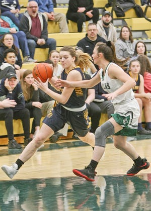 Quabbin senior captain Julia Hamel, shown driving against an Oakmont defender in a file photo from January 2019, could start at forward or point guard for the Panthers this winter.