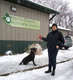 """Karen Russell, outgoing president of the Henry County Humane Society, takes """"Rudy,"""" for a walk outside in cold and snowy weather conditions. """"Rudy"""" is one of the current """"residents"""" at the Geneseo Shelter."""