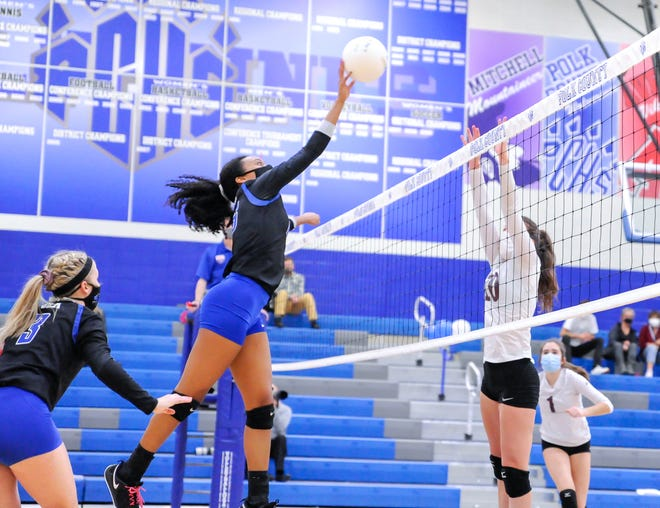 Polk County's Marissa Twitty returns a shot against Owen during Saturday's match at Polk.