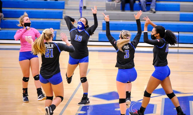 Polk County's volleyball players celebrate a point during Saturday's 3-0 win over Owen in the Western Highlands Conference championship match at Polk.