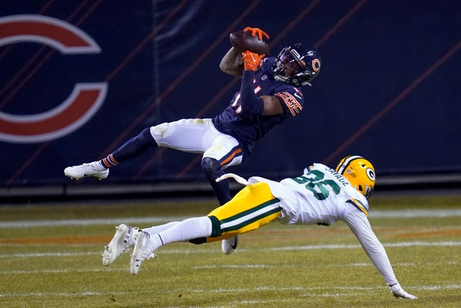 Chicago Bears' Darnell Mooney catches a pass in front of Green Bay Packers' Darnell Savage during the second half of an NFL football game Sunday, Jan. 3, 2021, in Chicago.