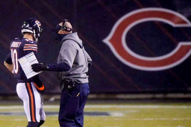 Chicago Bears head coach Matt Nagy talks to quarterback Mitchell Trubisky during the first half of an NFL football game against the Green Bay Packers Sunday, Jan. 3, 2021, in Chicago.