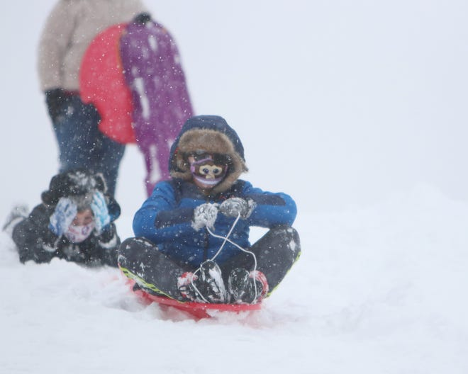 A number of families spent New Year's Day sledding after snow fell on the area. Winter break came to a close Monday as students in Newton USD 373 went back to school — either online or in school buildings. For more photos of winter fun, visit thekansan.com