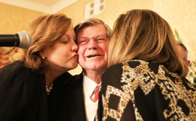 Adrian King receives kisses on both cheeks by Frances Theodorakis, left, and June Cummings after King was named the 2019 Kinston-Lenoir County Chamber of Commerce Citizen of the Year Thursday evening, Jan. 23, 2020 at the Kinston Country Club.