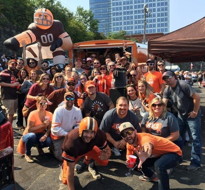 Members of the Greater Bacon Browns Backers gather before a game.