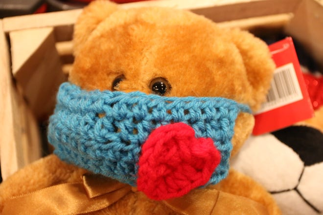 Teddy bears with handknit accessories are available for purchase at The Gardener's Spot. All proceeds benefit Warmer Winters, Inc.