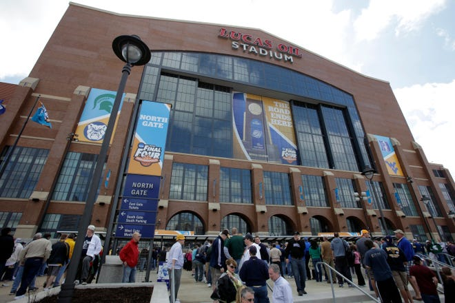 FILE - Fans arrive at Lucas Oil Stadium before a men's NCAA Final Four semifinal college basketball game between Butler and Michigan State in Indianapolis, in this April 3, 2010, file photo.