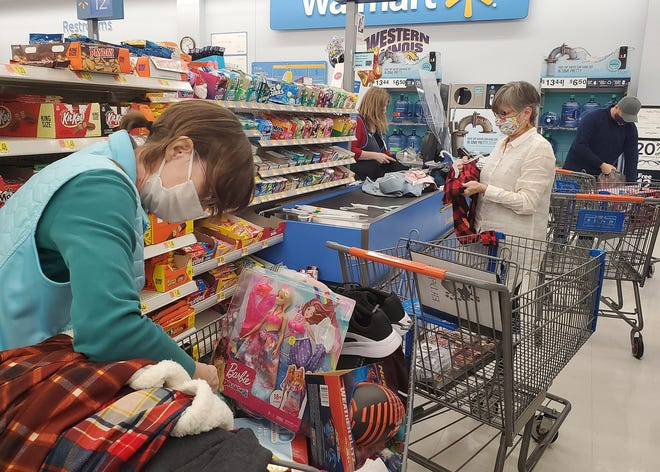 """During the pandemic, Project Santa """"elves"""" practiced social distancing to shop safely for thousands of items on children's wish lists."""