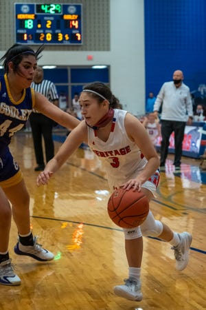 Heritage junior Elise Stafford (3) drives toward the basket in a recent District 11-4A home game against Godley. The Jaguars improved to 4-0 in district play with a 61-28 home win against Life Waxahachie.