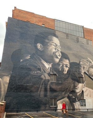 The John Lewis tribute mural is seen on State Street in Rochester.