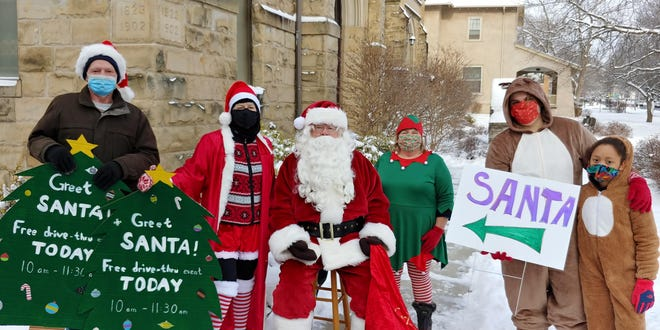 Santa Claus stops by First United Methodist Church of Canandaigua for a drive-thru meet-and-greet.