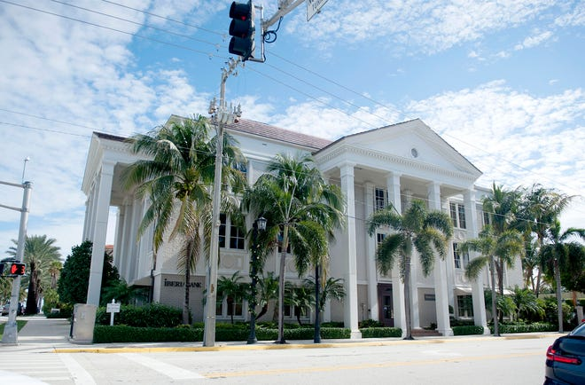 A half-acre property that is home to the Iberia Bank building at 180 Royal Palm Way changed hands as part of a five-property deal recorded Monday at $26 million in Palm Beach. The Frisbie Group and partners were the buyers.