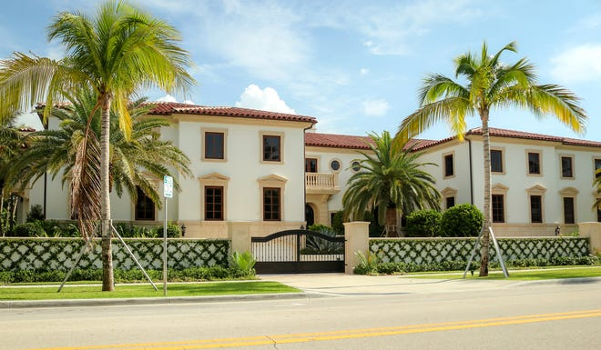 A never-lived-in condominium at 219 Brazilian Ave. just sold for a recorded $6.05 million, the last of the four units in the Palazzo Villas development to change hands. The arched front door of condo can be seen behind the gate in the center.