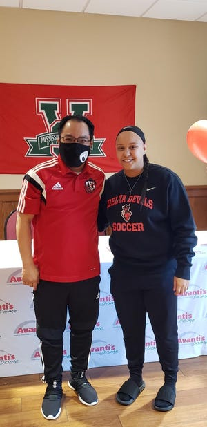 Pekin girls soccer coach Edgar Sandoval congratulates goalie Paige Smith after Smith signed with Mississippi Valley State University. The signing took place Dec. 27 at the Avanti's Dome in Pekin.