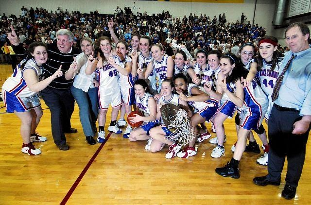 The Winnacunnet High School girls basketball team celebrated the Class L championship in 2007, the first of five straight Class L/Division I titles under coach Ed Beattie.