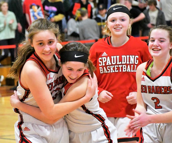Spaulding's Mary Paradis, left, and Abby Ward hug after the Red Raiders beat Bishop Brady in the 2020 Division II girls basketball semifinals. Spaulding was later declared co-champs with Lebanon.
