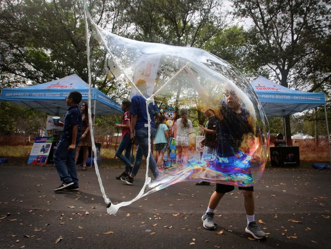 Five-year-old Cooper Johnson makes a large bubble at the booth of Mad Science at last year's ArtiGras Fine Arts Festival in Jupiter. The 36th annual event will be held Feb. 13-14 at the Gardens North County District Park in Palm Beach Gardens.