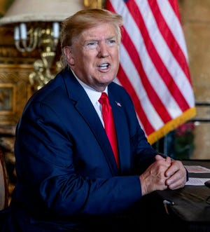 President Donald Trump speaks to the media after making a Christmas eve video conference call to members of the armed forces from Mar-a-Lago in Palm Beach, FL on Tuesday December 24, 2019.  RICHARD GRAULICH/palmbeachpost