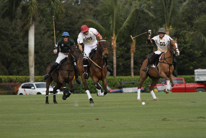 Palm Beach Equine's Gringo Colombres brings the ball downfield during the season-opening match Sunday at International Polo Club Palm Beach.