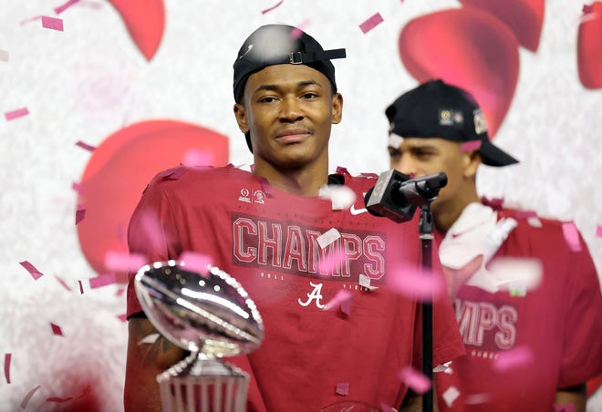 Alabama wide receiver DeVonta Smith celebrates after the Crimson Tide's win over Notre Dame in the College Football Playoff semifinal at AT&T Stadium in Arlington, Texas. Smith was the game's offensive MVP.