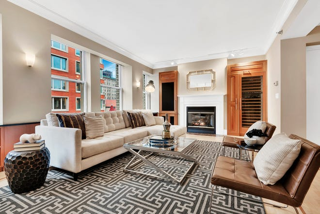 An affordable indoor/outdoor rug adds graphic interest to this living room space.