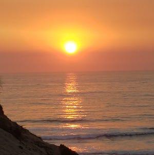 The sun sets over the Sanctuary's beach in Marina.