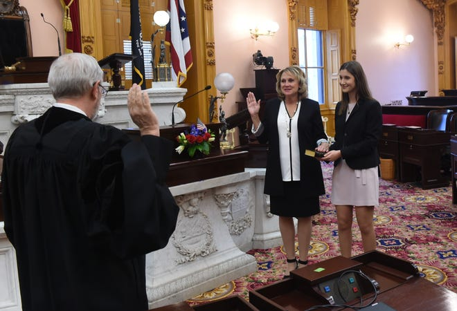 Gail Pavliga was sworn in Monday for her first term as the state representative for the 75th Ohio House District. Justice Patrick Fischer of the Ohio Supreme Court administers the oath of office. With Pavliga is her legislative aide, Miranda Derflinger.