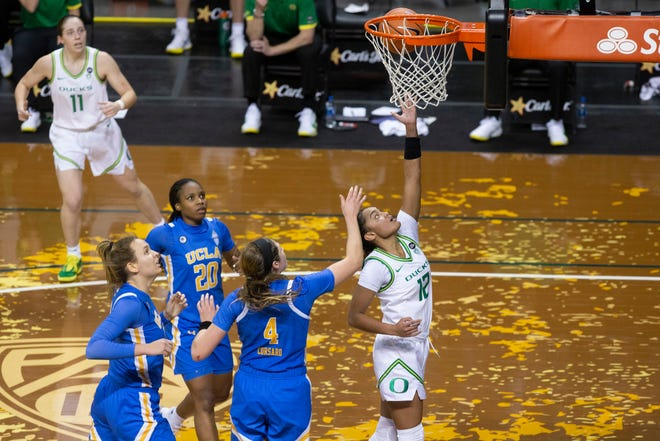 Oregon's Te-Hina Paopao, right, beats the UCLA defense to the basket during their first meeting this season on Jan. 3 at Matthew Knight Arena.