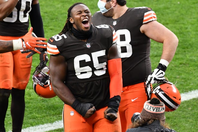 Browns defensive tackle Larry Ogunjobi (65) celebrates after the Browns beat the Steelers and secured a playoff berth, Sunday, Jan. 3, 2021, in Cleveland [Ken Blaze/USA TODAY Sports]