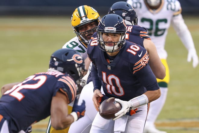 Chicago Bears quarterback Mitchell Trubisky (10) looks to hand the ball off to running back David Montgomery against the Green Bay Packers during the first half of an NFL football game on Sunday, Jan. 3, 2021, in Chicago.