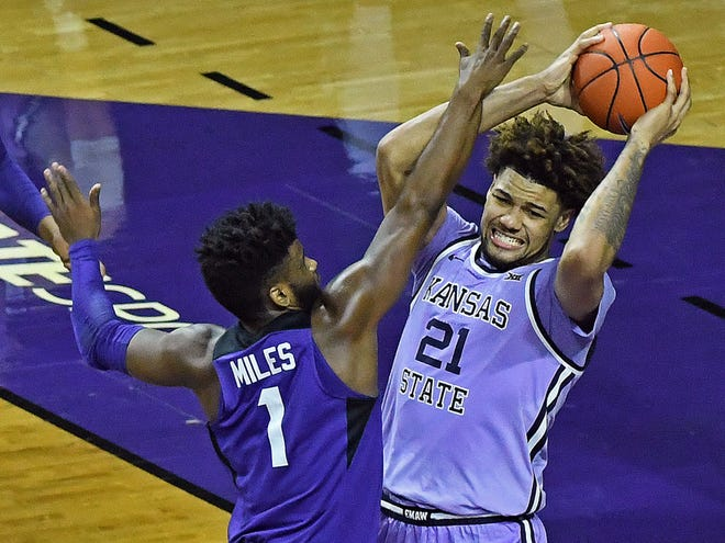 Kansas State center Davion Bradford is guarded by TCU's Mike Miles during Saturday's game at Bramlage Coliseum in Manhattan.