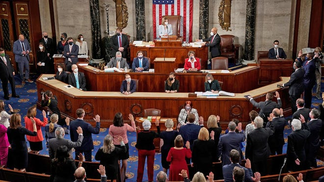 House Speaker Nancy Pelosi swore in the freshman members of the 117th Congress late Sunday afternoon, including U.S. Rep. Tracey Mann, R-Kan., Sunday afternoon.