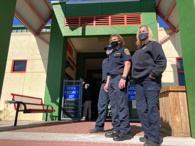 St. Johns County Fire Rescue Lt. Russell Henry, Fire Rescue Lt. Jason Burrell and Fire Rescue spokeswoman Greta Hall stand outside of the Solomon Calhoun Center in St. Johns County, where officials worked on administering 200 doses of Moderna's COVID-19 vaccine on Monday.