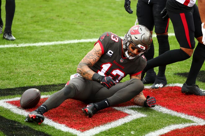 Tampa Bay wide receiver Mike Evans injured his leg during the first half Sunday against Atlanta. An MRI showed no structural damage, the team said.