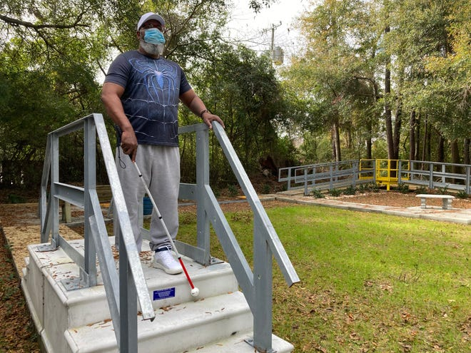 Corey Brooks navigates a mobility sidewalk at the Savannah Center for the Blind and Low Vision.