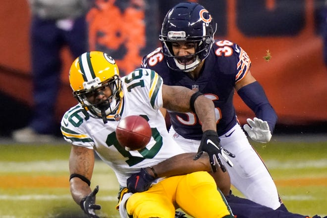 Green Bay Packers' Tavon Austin fumbles in front of Chicago Bears' DeAndre Houston-Carson on Sunday, Jan. 3, 2021, in Chicago. The Bears recovered the fumble.
