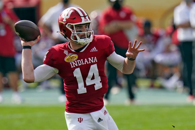 Indiana quarterback Jack Tuttle throws a pass in the Outback Bowl on Saturday, Jan. 2, 2021, in Tampa, Fla.