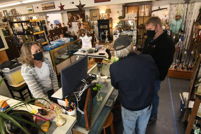 "Renee Callahan talks with customers at Myer's Attic in the ""Old Wilson's"" grocery store building in Castle Hayne the building has housed various businesses over the years."